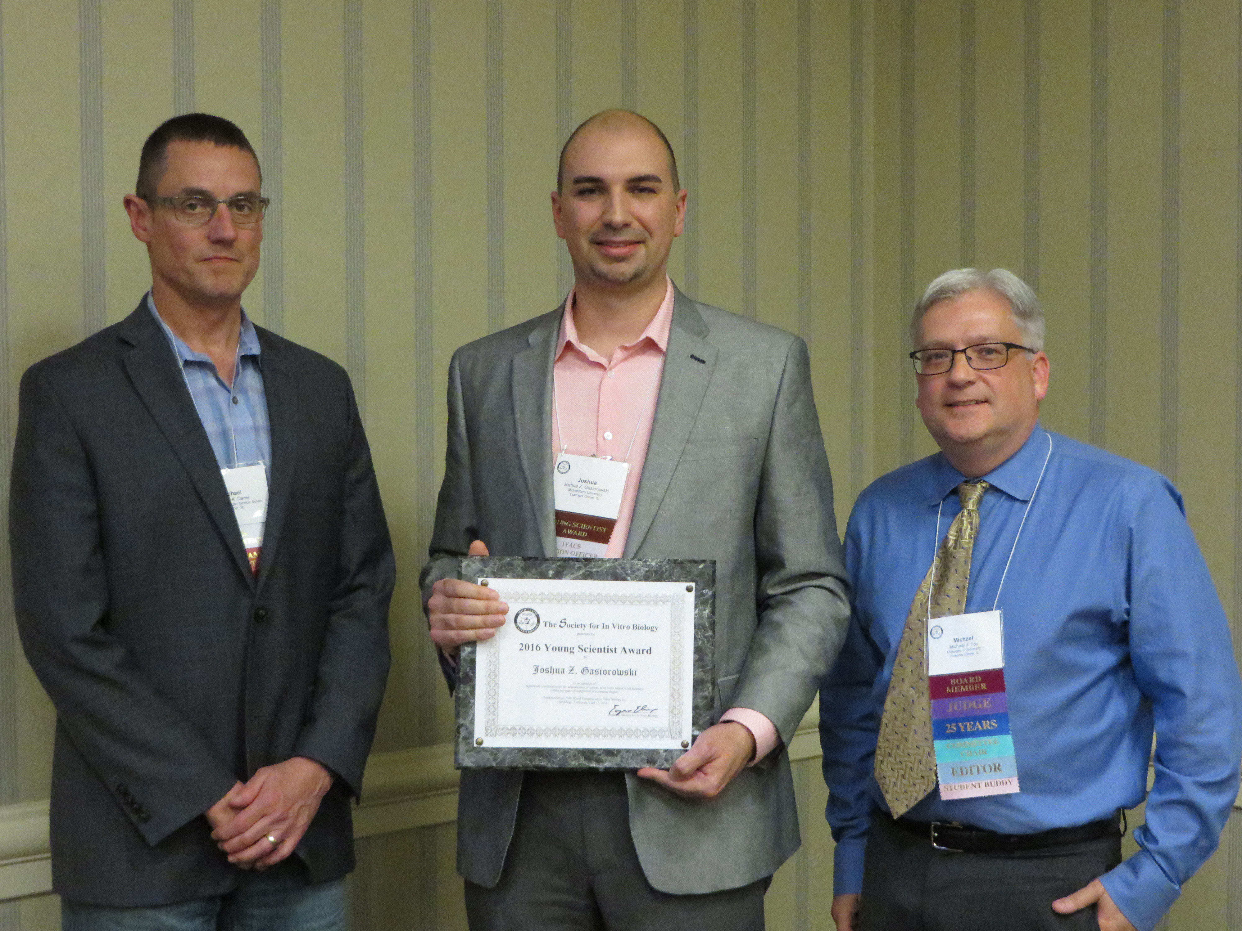Joshua Gasiorowski (C) receives the Young Scientist Award from Michael Dame (L) and Michael Fay(R).