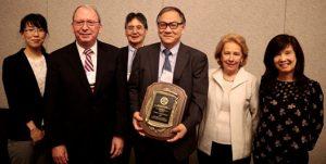 2019 IVACS Lifetime Achievement Award presentation: (L to R) Dr. Atsuko Hamada, Dr. John Harbell (SIVB President), Dr. J. Denry Sato, Dr. Tetsuji Okamoto (Awardee), Dr. Sandra Schneider (Past President), and Dr. Anh D. Le.